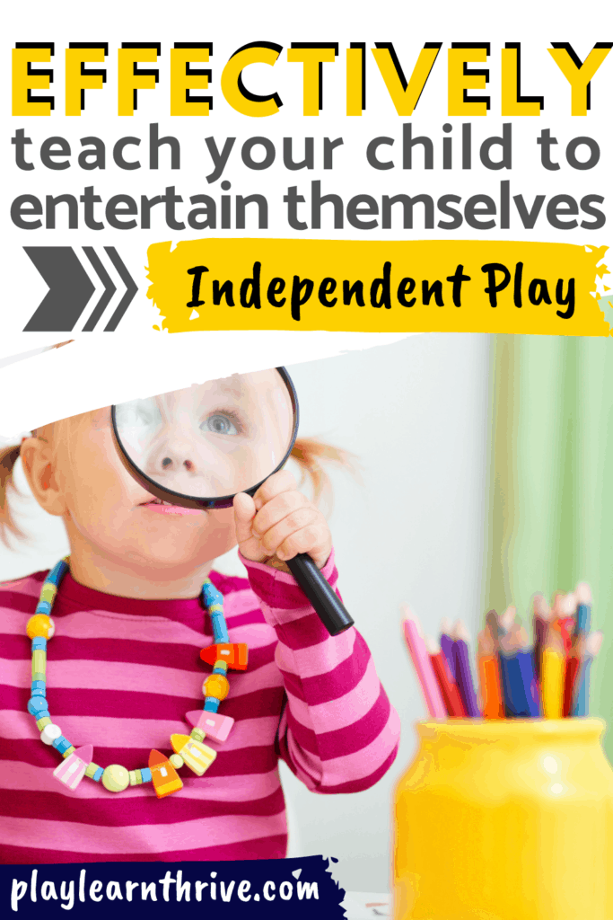 A little girl in a pink and red stripped shirt holds a magnifying glass up to her eye exploring independent play on her own learning how to play by herself.
